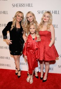 Emily Alyn Lind with mother and sisters