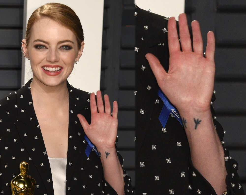 Emma Stone bird feet wrist tattoo