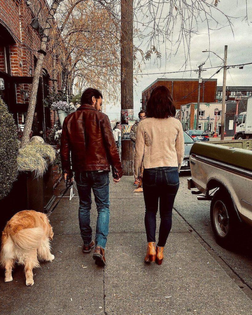 Tyler Hynes with girlfriend Erin Krakow walking with a dog